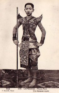 Royal dancer, Phnom Penh (undated), by P. Dieulefils. Given that Cambodian women customarily cut their hair short on marriage, this could be, and probably is, a female dancer.