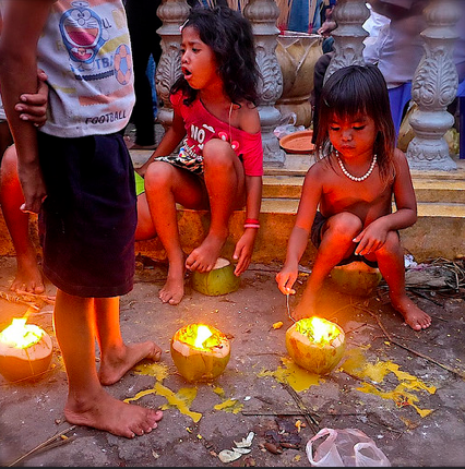 Coconut-shell candles at Preah Ang Doung Kar on a festival-day