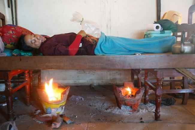 Nigel Dickson, Photoshelter.com - Yu Sokna and her baby undergoing