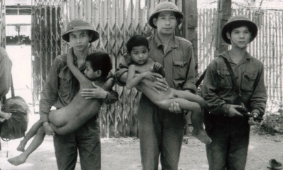 Vietnamese-solders-assist-two-children-who-were-searching-for-their-mother-in-S-21-at-the-fall-of-Phnom-Penh